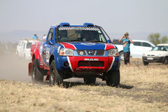 Speeding red and blue Toyota Nissan single cab rally car front v. Sun City, South Africa – OCTOBER 1, 2016: Front view of Speeding red and blue Toyota stock images