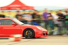 Speeding red car. A red car speeding on a race track Stock Images