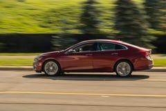 Speeding red full size sedan in motion royalty free stock photos