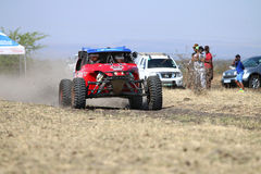 Speeding red Porter rally car front view. Sun City, South Africa – OCTOBER 1, 2016: Front view of Speeding red Porter rally car in race at Sun City 450 royalty free stock image