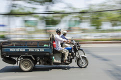 Speeding scooter truck Vietnam Stock Photography