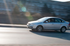Speeding sedan Royalty Free Stock Image