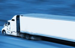 Speeding Semi Truck. On the Highway. Blue Color Grading with Motion Blur. Transport and Logistics Concept Stock Photo