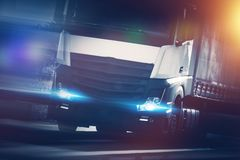 Speeding Semi Truck. Speeding Modern Semi Truck Concept Photo. Euro Tracking and Spedition Theme Stock Photo