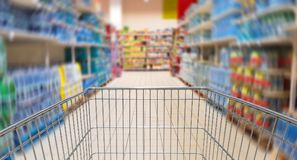 Speeding mall aisle with shopping cart Stock Image