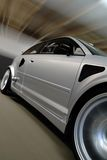 Speeding Silver Car. Moving Car with Motion Blur Stock Images