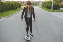 Speeding skateboarding woman at city stock photography