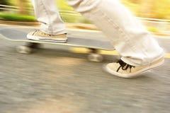 Speeding skateboarding woman Royalty Free Stock Image