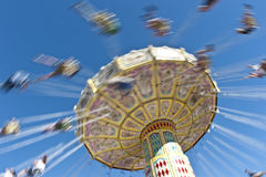 Speeding Spinning Carousel at the show. Speeding Spinning Carousel at the royal easter show sydney april 9th 2012. Copyspace stock photos
