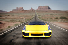 Speeding sports car. On long open highway Royalty Free Stock Image