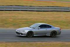 Speeding sports car in race Stock Images