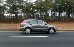 Speeding SUV. An SUV is speeding along a highway royalty free stock images