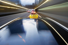 Speeding taxi. Taxi being pulled over by a police car for speeding Royalty Free Stock Photo