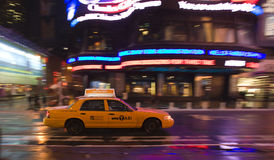Speeding taxi Royalty Free Stock Images