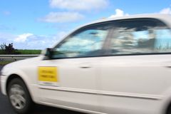 Speeding Taxi blur movement royalty free stock image