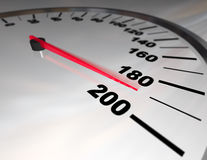Speeding to the Limit. A white automobile speedometer with red needle pushing toward 200 Royalty Free Stock Photo