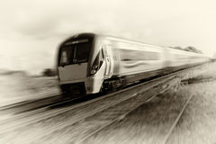 Speeding train 2010 sepia tonning Royalty Free Stock Photos