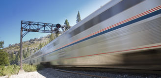 Speeding Train. A passenger train speeds by in the Sierra Nevada mountains Royalty Free Stock Photography