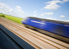 Speeding Train. With motion blur on a sunny day stock photo