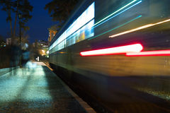 Speeding train at night Stock Photography