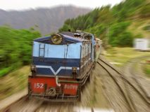 Speeding train railroad blurs. View of speeding train in scenic himalayan mountain ranges. This railroad section of Indian Railways is now a declared  UN Unesco Stock Image