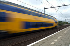 Speeding Train. Train speeds through the station at Voorhout, the Netherlands Stock Photos