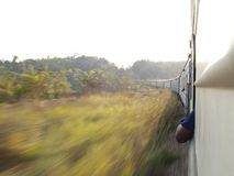 Speeding train in Tanzania. Speeding train viewed from window, Tanzania Royalty Free Stock Photo