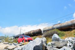 Speeding train. A speeding train whizzing past a parked car Royalty Free Stock Photos