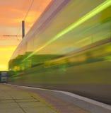 Speeding Tram at Sunset Royalty Free Stock Photography