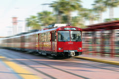Speeding Trolley. Red speeding trolley in San Diego, CA. San Diego blue line Royalty Free Stock Photos