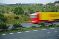 Speeding truck. Big truck moving with high speed on German highway Royalty Free Stock Images