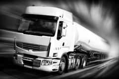 Speeding truck with fuel tank. Black and white illustration Stock Image