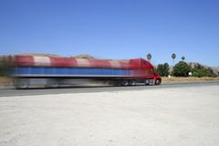 Speeding truck on highway (with speed blur) Royalty Free Stock Photography