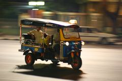 Speeding Tuc Tuc in Thailand. Speeding Motorcycle with blurred backgroung to generate movement stock image