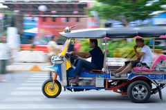 Speeding Tuk Tuk in Bangkok. Speeding Tuk Tuk Taxi in China Town, Bangkok Royalty Free Stock Photo