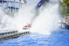 Speeding water roller coaster family fun. Very high resolution, 42.2 megapixels. People's expression shortly before the splash into the water of a roller coaster Stock Photos