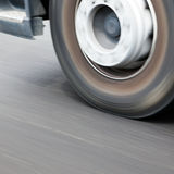 Speeding Wheel. A view of a speeding wheel of a truck in motion Royalty Free Stock Photo