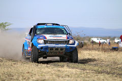 Speeding white and blue Ford Ranger rally car front view Stock Photography