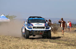 Speeding white and blue Ford Ranger rally car front view Stock Photo
