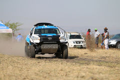 Speeding white and blue Toyota Hilux twin cab rally car front vi. Sun City, South Africa – OCTOBER 1, 2016: Front view of Speeding white and blue Toyota stock photos