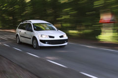 Speeding white car Stock Photos