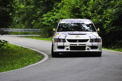 Speeding white rally car Stock Photography