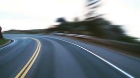 Speeding on winding coastal road stock footage
