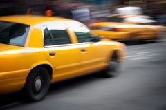 Speeding Yellow Taxi Cabs Motion Royalty Free Stock Photos