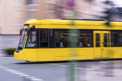 Speeding yellow tram Royalty Free Stock Photos