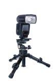 Speedlight com mini tripé Fotos de Stock Royalty Free