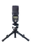 Speedlight con el mini trípode Foto de archivo libre de regalías