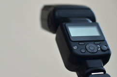 Speedlight gun with trigger set mounted on tripod Royalty Free Stock Images