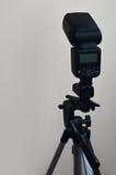 Speedlight gun with trigger set mounted on tripod Stock Photos