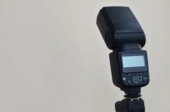 Speedlight gun with trigger set mounted on tripod Royalty Free Stock Photography